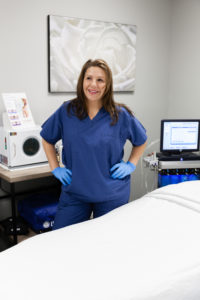 Professional esthetician, Jennifer Fond, in skin care treatment area